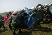 Demonstrators get attacked by the police. G8 summit protests in Heiligendamm, Rostock, Germany. - Jess Hurd - 07-06-2007