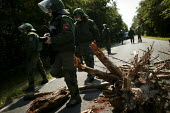 Protesters block the road with branches at the G8 summit in Heiligendamm, Rostock, Germany. - Jess Hurd - 07-06-2007