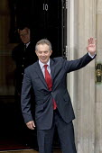 Tony Blair stands and waves at the entrance to Number 10 Downing Street for the last time after resigning as British Prime Minister - Jess Hurd - 2000s,2007,entrance,Labour Party,Minister,Street