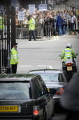 Tony Blair leaving Downing Street, vehicle convoy passes anti war demonstrators as he resigns as Prime Minister, London - Jess Hurd - 2000s,2007,bike,bikes,good riddance,Labour Party,land rover,leaves,leaving,London,Minister,motorbike,MOTORBIKES,motorcycle,MOTORCYCLES,motorcycling,mp,mps,placard,placards,pol,political,politician,pol