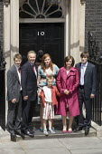 Tony Blair and his family stand at the entrance to Number 10 Downing Street for the last time as Blair retires as British Prime Minister. - Jess Hurd - 2000s,2007,entrance,families,family,Labour Party,people,pol politics,Street