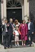 Tony Blair and his family stand at the entrance to Number 10 Downing Street for the last time as Blair retires as British Prime Minister. - Jess Hurd - 2000s,2007,entrance,families,family,Labour Party,people,Street
