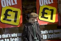 Elderly man sits outside Iceland supermarket, Watney Market, Tower Hamlets, East London. - Jess Hurd - 11-08-2007