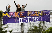 Make Planes History banner. 24hrs of mass action at Camp for Climate Action at Heathrow, the world's busiest airport and a big source of CO2 emissions. London. - Jess Hurd - 2000s,2007,3rd,action,activist,activists,against,Airports,Authority,BAA,banner,banners,British,Camp,campaign,campaigner,campaigners,campaigning,CAMPAIGNS,camps,carbon,Climate,Climate Change,DEMONSTRAT