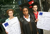 Qualifications and Curriculum Authority with report cards by a group of QCA PCS members to highlight problems with pay and relocation. Piccadilly, London. - Jess Hurd - 2000s,2007,activist,activists,BME Black minority ethnic,campaign,campaigner,campaigners,campaigning,CAMPAIGNS,DEMONSTRATING,demonstration,DEMONSTRATIONS,education,member,member members,members,PCS,peo