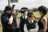 Protester attemps to stop the police FIT filming. Camp for Climate Action at Heathrow, the worlds busiest airport and a big source of CO2 emissions. London. - Jess Hurd - 15-08-2007