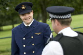 Protestor dressed as a pilot is stopped at the camp cordon by police. Camp for Climate Action at Heathrow, the worlds busiest airport and a big source of CO2 emissions. London. - Jess Hurd - 15-08-2007