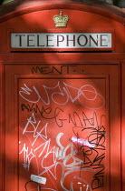 Graffiti on a London telephone box. - Jess Hurd - 2000s,2007,box,boxes,cities,city,CLJ,communicating,communication,graffiti,London,phone,PHONES,red,SOI social issues,tag,tags,telephone,telephones,urban