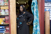 Somali shopkeeper, Brent, London. - Jess Hurd - 15-09-2007