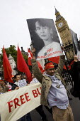 Free Aung San Suu Kyi placard. Campaigners for democracy in Burma, Parliament Square. London. - Jess Hurd - ,2000s,2007,activist,activists,Burma,Burmese,CAMPAIGN,campaigner,Campaigners,CAMPAIGNING,CAMPAIGNS,democracy,DEMONSTRATING,demonstration,DEMONSTRATIONS,female,Parliament,people,person,persons,protest,