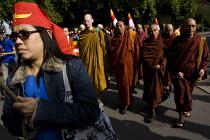 Buddhist monks lead a demonstration for democracy in Burma, Battersea, London. - Jess Hurd - &,2000s,2007,activist,activists,belief,buddha,Buddhism,buddhist,buddhists,Burma,Burmese,CAMPAIGN,campaigner,campaigners,CAMPAIGNING,CAMPAIGNS,conviction,democracy,DEMONSTRATING,demonstration,DEMONSTRA