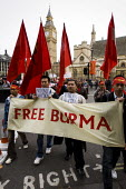 Campaigners for democracy in Burma, Parliament Square. London. - Jess Hurd - 2000s,2007,activist,activists,Burma,Burmese,CAMPAIGN,campaigner,Campaigners,CAMPAIGNING,CAMPAIGNS,democracy,DEMONSTRATING,demonstration,DEMONSTRATIONS,Parliament,protest,PROTESTER,PROTESTERS,protestin