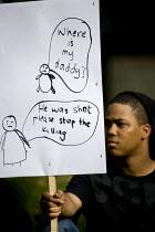 Families march against gun crime from Hackney - Tottenham, London. - Jess Hurd - 2000s,2007,activist,activists,adolescence,adolescent,adolescents,against,BME Black Minority Ethnic,boy,boys,CAMPAIGN,campaigner,campaigners,CAMPAIGNING,CAMPAIGNS,child,CHILDHOOD,children,cities,city,c