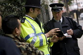 Young Muslim men get stopped and searched by police officers as a far-right organisation Stop the Islamisation of Europe holds its first demonstration in London to coincide with the USA Islamo-fascism... - Jess Hurd - 26-10-2007