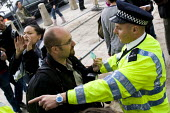 Associated Press photographer Lefteris Pitarakis shows his press card as he is confronted by a policeman on a Stop the War demonstration on the opening day of Parliament, London. - Jess Hurd - 2000s,2007,activist,activists,adult,adults,anti war,CAMPAIGN,campaigner,campaigners,CAMPAIGNING,CAMPAIGNS,CLJ,DEMONSTRATING,demonstration,DEMONSTRATIONS,force,harassment,journalism,journalist,journali
