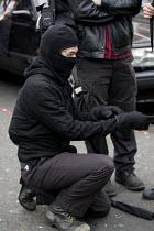 Anarchist with uniform. Bash The rich, Class War demonstration, Notting Hill, London - Jess Hurd - 2000s,2007,activist,activists,AFFLUENCE,AFFLUENT,against,anarchism,anarchist,anarchists,anarchy,anti,balaclava,black,Bourgeoisie,CAMPAIGN,campaigner,campaigners,CAMPAIGNING,CAMPAIGNS,DEMONSTRATING,dem