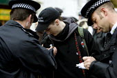 Anarchist is stopped and searched by police on a Bash The rich, Class War demonstration, Notting Hill, London - Jess Hurd - 03-11-2007