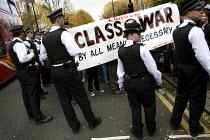 Bash The rich, Class War demonstration, Notting hill. London. - Jess Hurd - 2000s,2007,activist,activists,Anarchism,anarchist,Anarchists,anarchy,anti rich,CAMPAIGN,campaigner,campaigners,CAMPAIGNING,CAMPAIGNS,CLJ,DEMONSTRATING,demonstration,DEMONSTRATIONS,metropolitan police