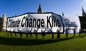 World Development Movement banner, Climate Change Kills. Parliament Square. Westminster. - Jess Hurd - ,2000s,2007,activist,activists,CAMPAIGN,campaigner,campaigners,CAMPAIGNING,CAMPAIGNS,DEMONSTRATING,demonstration,DEMONSTRATIONS,Development,eni environmental issues,Global Warming,Movement,Parliament,