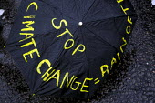 International Climate Protest, London. - Jess Hurd - ,2000s,2007,activist,activists,CAMPAIGN,campaigner,campaigners,CAMPAIGNING,CAMPAIGNS,Change,Climate Change,DEMONSTRATING,DEMONSTRATION,DEMONSTRATIONS,ENI Environmental Issues,Global Warming,Protest,PR