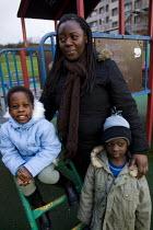 Mary Semirimu, Ugandan asylum seeker with her family who have been granted refugee status. Glasgow, Scotland. - Jess Hurd - 29-12-2007