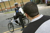 PCSO, Police Community Support Officer patrols his West London patch by bike. - Jess Hurd - 2000s,2007,adult,adults,beat,bicycle,bicycles,BICYCLING,Bicyclist,Bicyclists,bike,bikes,BME Black minority ethnic,cities,city,CLJ crime,communicating,communication,communities,Community,conversation,c