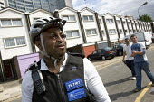 PCSO, Police Community Support Officer patrols his West London patch by bike. - Jess Hurd - 2000s,2007,adolescence,adolescent,adolescents,adult,adults,beat,bicycle,bicycles,BICYCLING,Bicyclist,Bicyclists,bike,bikes,BME Black minority ethnic,cities,city,CLJ crime,communities,Community,cycle,c