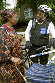 PCSO, Police Community Support Officer patrols his West London patch by bike. - Jess Hurd - 28-08-2007