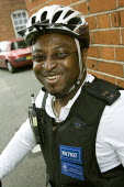 PCSO, Police Community Support Officer patrols his West London patch by bike. - Jess Hurd - 2000s,2007,adult,adults,beat,bicycle,bicycles,BICYCLING,Bicyclist,Bicyclists,bike,bikes,BME Black minority ethnic,cities,city,CLJ crime,communities,Community,cycle,cycles,cycling,Cyclist,Cyclists,forc