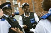 PCSO, Police Community Support Officer patrols his West London patch by bike. - Jess Hurd - ,2000s,2007,adult,adults,beat,BME Black minority ethnic,cities,city,CLJ crime,communicating,communication,communities,Community,conversation,dialogue,force,job,jobs,LAB LBR Work,London,male,man,MATURE