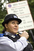 PCSO, Police Community Support Officer on traffic duty in Westminster, London. - Jess Hurd - ,2000s,2007,adult,adults,beat,cities,city,CLJ Crime Law and Justice,communicating,communication,communications,communities,Community,FEMALE,force,issuing,job,jobs,LAB LBR Work,London,MATURE,message,me