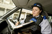 PCSO, Police Community Support Officer on traffic duty in Westminster, London. - Jess Hurd - 2000s,2007,adult,adults,AUTO,AUTOMOBILE,AUTOMOBILES,AUTOMOTIVE,beat,car,cars,cities,city,CLJ Crime Law and Justice,communities,Community,FEMALE,force,form,forms,issuing,job,jobs,LAB LBR Work,London,ma