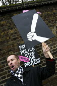 Anarchist demonstrates against police protest over pay. London. - Jess Hurd - 23-01-2008