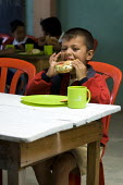 Children have lunch at a community subsidised kitchen. Cuidad Bolivar, South Bogota, Colombia. - Jess Hurd - 07-02-2008
