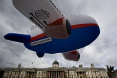 Giant climate change kills WDM inflatable plane flies above Trafalgar Square. Campaigners from the World Development Movement are raising awareness of the dangers that flying causes to the planet and... - Jess Hurd - 2000s,2008,activist,activists,aeroplane,AEROPLANES,air transport,aircraft,aviation,CAMPAIGN,campaigner,Campaigners,CAMPAIGNING,CAMPAIGNS,Climate Change,co2,degradation,DEMONSTRATING,demonstration,DEMO