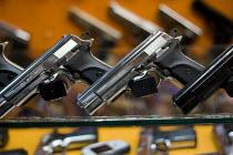 Browning and Beretta guns in a handgun market. Istanbul, Turkey. - Jess Hurd - 14-03-2008