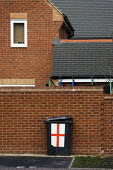 Suburban housing with an England flag wheelie bin. Reading. - Jess Hurd - 2000s,2008,bin,bins,C,collection,Council Services,Council Services,cover,Cross,england,english,flag,flags,georges,George's,house,houses,housing,local authority,nationalistic,new,patriot,patriotic,patr