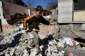 Child runs through the rubble of an already demolished house as the council clears Sulukule, an historic gypsy area. Istanbul, Turkey. - Jess Hurd - 2000s,2008,Asia,asian,asians,BME minority ethnic,boy,boys,child,CHILDHOOD,children,cities,city,clearance,CLEARENCE,communities,community,council,demolish,DEMOLISHED,demolishing,demolition,developer,de