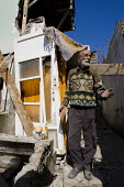 Sabahattin Kayihan tries to stop his house being demolished in a forced clearance of a historic gypsy area called Sulukule. Istanbul, Turkey. - Jess Hurd - 16-03-2008