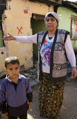 Sevtap Galaza, whose house is marked with an X for demolition. Forced clearance of Sulukule, an historic gypsy area. Istanbul, Turkey - Jess Hurd - 2000s,2008,activist,activists,adult,adults,against,Asia,asian,asians,BME minority ethnic,boy,boys,CAMPAIGN,campaigner,campaigners,CAMPAIGNING,CAMPAIGNS,child,CHILDHOOD,children,cities,city,clearance,C