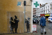 Mural painted by street artist Banksy depicting two young children saluting while another child raises a Tesco carrier bag on a flagpole. Essex Road, London. - Jess Hurd - 01-05-2008
