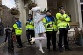 Space Hijackers with policemen celebrating a traditional May Day, Mayfair, London. - Jess Hurd - 01-05-2008