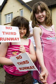Protest against the third runway at Heathrow airport. West London. - Jess Hurd - ,2000s,2008,3rd,activist,activists,against,anti,campaign,campaigner,campaigners,campaigning,CAMPAIGNS,carbon,child,CHILDHOOD,children,Climate Change,DEMONSTRATING,demonstration,DEMONSTRATIONS,emission