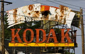 Damaged and disused Eastman Kodak Co dealer sign, once the largest maker of photographic film and once at the forfront of digital photography, Atlanta, Georgia. USA. - Jess Hurd - 17-06-2008