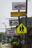 Signs advertising loans and cash till payday. Birmingham, Alabama, USA. - Jess Hurd - 17-06-2008
