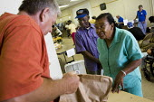 Elma Ambrose, age 73 visits the Society of St Vincent de Paul, Catholic charity providing assistance to low income families in Greenville, Mississippi. USA. - Jess Hurd - &,2000s,2008,adult,adults,African American,African Americans,age,ageing population,America,american,americans,assistance,BAME,BAMEs,belief,black,BME,BME black minority ethnic,bmes,Catholic,catholicism