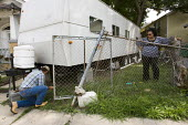 Woman has her FEMA trailer removed because of the formaldehyde threat. New Orleans, Louisiana. USA. - Jess Hurd - 22-06-2008
