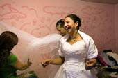 Roma Gypsy wedding in Rome where the bride is traditionally dressed by two virgins. Italy. - Jess Hurd - 2000s,2008,BAME,BAMEs,BME,bmes,bride,brides,Diaspora,diversity,dress,EMOTION,EMOTIONAL,EMOTIONS,ethnic,ethnicity,eu,Europe,european,europeans,eurozone,FEMALE,foreign,foreigner,foreigners,funny,Getting