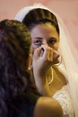 Roma Gypsy wedding in Rome where the bride is traditionally dressed by two virgins. Italy. - Jess Hurd - 27-07-2008