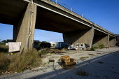 Roma Gypsy camp underneath a motorway flyover in South West Rome, Italy. - Jess Hurd - 2000s,2008,BAME,BAMEs,BME,bmes,camp,camps,communities,community,diversity,EQUALITY,ethnic,ethnicity,eu,Europe,european,europeans,eurozone,excluded,exclusion,gipsey,Gipsey Gipsy Gypsey,Gipsies,Gipsy,gy